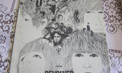 The Beatles Revolver in fantastic condition, Capitol ST 2575. Paper liner over record. Has plastic overwrap still over cover; cover in very good condition. Record in near mint condition.