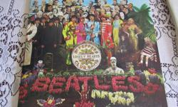 The Beatles Sgt. Peppers Lonely Hearts Club Band LP/record in fantastic condition, Capitol SMAS 2653. Plastic liner over record. Cover in very good condition. Record is in near mint condition.