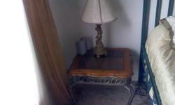 2 end tables and 1 coffee table. Steardy metal frame. Real wooden top with smoke glass inlay. tables in excellent condition. buyer must pick-up