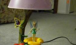 Brand New Cute lamp with tinkerbell that rotates and plays a tune. Cash Only