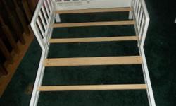 Toddler bed wood white takes a crib mattress. $20.00 --