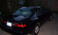 1997 Toyota Camry, Black, 2 owners, inspected and approved for sale through State of Michigan 4/2010. Automatic, moon roof, power windows, cd player/radio. Good body condition, routine maintenance up to date. Mostly highway miles. Great gas mileage.