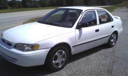 Toyota corolla 1999 4 door,ac ,auto transm,very good conditions,run good,white color,there are about 178.000 mile onthe engine and 210.000 mile on the body.any question call --