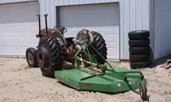 1958 Ford 881 Series 4cyl Deisel Tractor and 6ft. John Deere Mower - Tractor runs good and has good tires. BOTH for 4495.00. Contact Jim at (719) 338-3443.