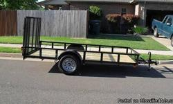 """Brand new 2010 5X14 utility trailer Trailer Features 3X2X3/16 angle iron frame construction 3X2 Wrap around tounge all the way to fenders 2 3/8 round pipe top rail 2"""" Bulldog coupler 2k set backjack Diamond Plate Fenders safety chains DOT approved lights"""
