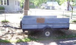 A LITTLE RUSTY AND COULD USE A NEW FLOOR BUT GREAT FOR HAULING LAWN TRACTORS, LEAVES, MULCH, ETC. CALL --