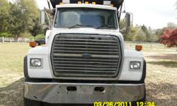 1996 ford L9000 factory dump eng is a 350 cat trans is a 8LL,the miles on truck is 300 K miles hendrickson susp bed is rough a/c works blows cool needs a shot of freon the motor does not have blow by runs and dumps good factory dump needs one bushing for