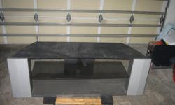 """good condition its gray and black with glass center stands about 24"""" off the ground and will hold up to a 75"""" tV call 909 987-6528 ASK FOR CHERYL"""
