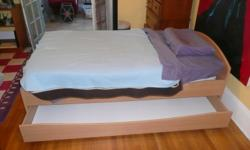 Twin bed with mattress and bedding. Great condition. Trundle good for storage. $175.00. Call for more info and/or directions. --