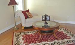Beautiful-Pristine--Like New--Upscale Living Room Set. La-Z-Boy Cream Suede Sofa/Chaise, Wood Coffee Table with glass insert, Pottery Barn Wool Area Rug (5 x 8), and Floor Lamp. Beautiful Set!