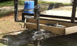 18' Utility Trailer with 3000lb electrical tounge lift. Fold down drive on ramps.