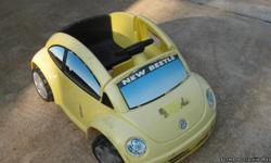 small battery operated. rides good age 2-4yrs depending on size of child.pic