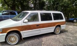 I am a nice 1994 Chrysler Town & Country Van. I have 173,300 miles and sit in my owners yard ready to be used. I barley use any oil. I run very well. I haven't been driven more than 100 miles per year in the past 10 years. I start up whenever he wants me