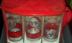 Coca-Cola Red Cooler Bag w/Set of 6 Glasses (missing one glass - sold with 5 glasses) Set of 5 Coca-Cola Glasses in a Red Cooler Bag. The top area holds all 6 glasses. The bottom area will hold your Coca-Cola. It also has a shoulder strap for easy