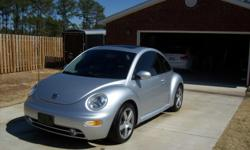 2002 VW Beetle Sport, 5 speed, 1.8 turbo, Silver with Black leather interior. Moon roof, Power windows, locks, Factory Monsoon stereo system with 6 disc cd changer. Rear spoiler and garage kept. Excellent condition and Only 55000 miles