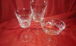 2 tall wine glasses, $50 each 5 iced beverage glasses, $60 each 3 squat champagne glasses, $50 each