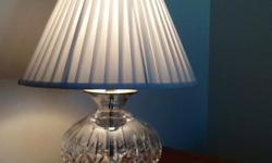 Beautiful Waterford crystal lamp with white silk shade, in excellent condition. Lamp measures 22 inches high
