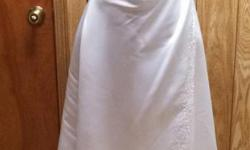 Wedding dress has been worn. Could be worn with or without straps. No train. Original price was $400.