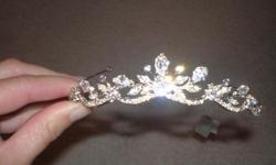 Never been worn, new, tags remain in place, in original packaging from the Headpiece Collection at David's Bridal. Silver, Crystallized with Swarovski crystals. Original price 129.00.