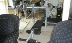 Magnum 350 bench with cross bar and leg curl. Very good condition.