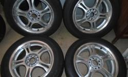"16"" Universal 5 lug wls w 205 55 16 fair -good tires.  501 399 9385"