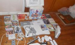 I am selling my wii, it comes with the game console, all cords and manuals, wii balance board, all accessories including 2 battery chargers, 2 slim controllers, 2 nunchucks, 1 regular controller and gun. The games that are included are wii active, wii