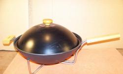This was only used a couple of times. 14 inch diameter with lid. Non-stick surface. Phone 704 927-8611 or email