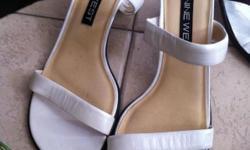 1) White Nine West size 7 (leather) $10.00 2) Black Sag Harbor size 7 brand new $10.00 3) Blue Sandals size 6 brand new $10.00 4) Black Guess Stilettos size 7.5 (leather) $10.00 5) Pumas Running Shoes (light gray) size 6.5 $5.00 se habla espanol