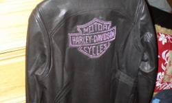 Size Large black leather jacket with Harley Davidson in Diamonds on the back. Paid $425 for it at Harley store. Also have size 8 Harley boots(new) and Harley biker glasses if intrested:) GREAT CHRISTMAS PRESENT!