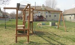 Two swings, Bar swing, Monkey Bars. Firemen pole, Two platform steps. Condition Used but good.