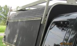 Truck cap for work truck. Easy access from sides or back, ladder rack.