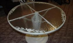 """White wrought iron table and chairs. Table has a glass top 41"""" in diameter and table is 29"""" high. Set of 4 chairs. All have padded seats and entire set is in very good shape. Table is very stable and easy to sit around with center base. Perfect set for a"""
