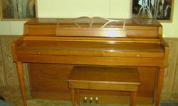 Wurlitzer spinet piano with bench for sale. It has a oak finish and is in excellent condition. Moving soon and I will not have room for it in my new place. If interested contact Bob at --