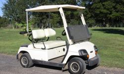 Yamahaa Electric 2001 Golf Cart, Model G196 Pacesetter. White in Color. It has been kept inside and is very clean and charges quickly and runs great!! It holds two golf bags in back. The upholstery is in good shape. Tires are