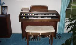 Yamaha BK 5 electric ORGAN with music. Reverb Auto Rhythm, tone levers, foot pedals, headphone jack American Walnut grain with bench and music $50. 410-647-8182
